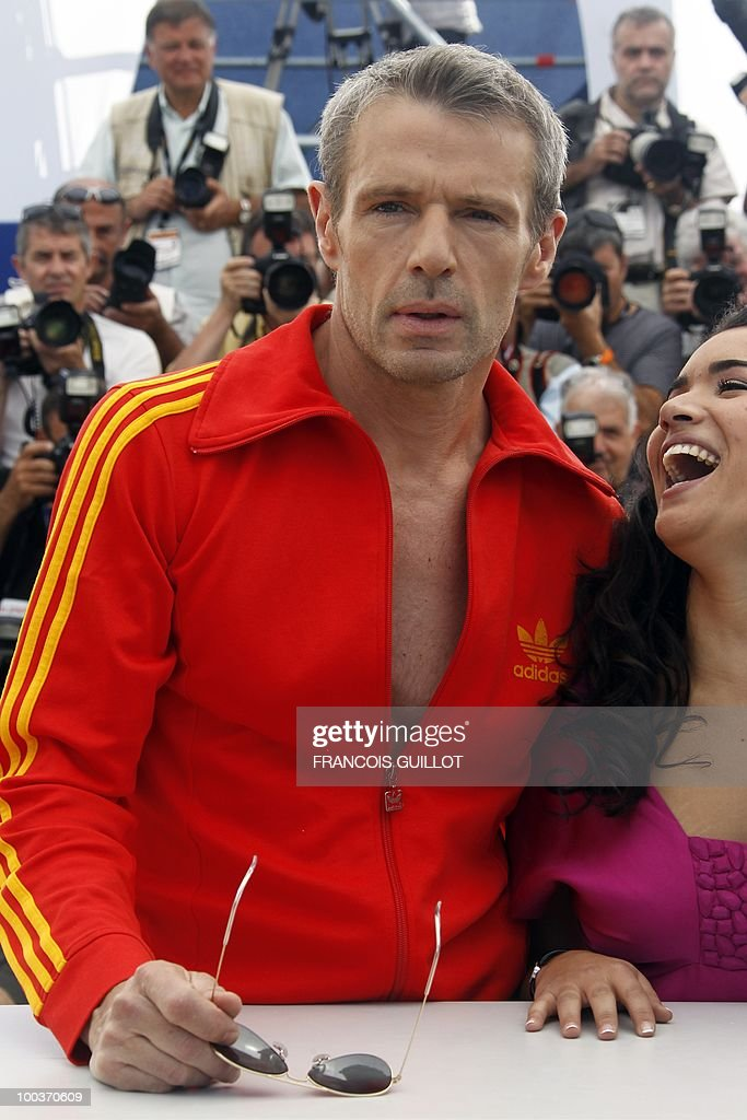 French actor Lambert Wilson and French actress Sabrina Ouazani pose during the photocall of 'Des Hommes et des Dieux' (Of God and Men) presented in competition at the 63rd Cannes Film Festival on May 18, 2010 in Cannes.