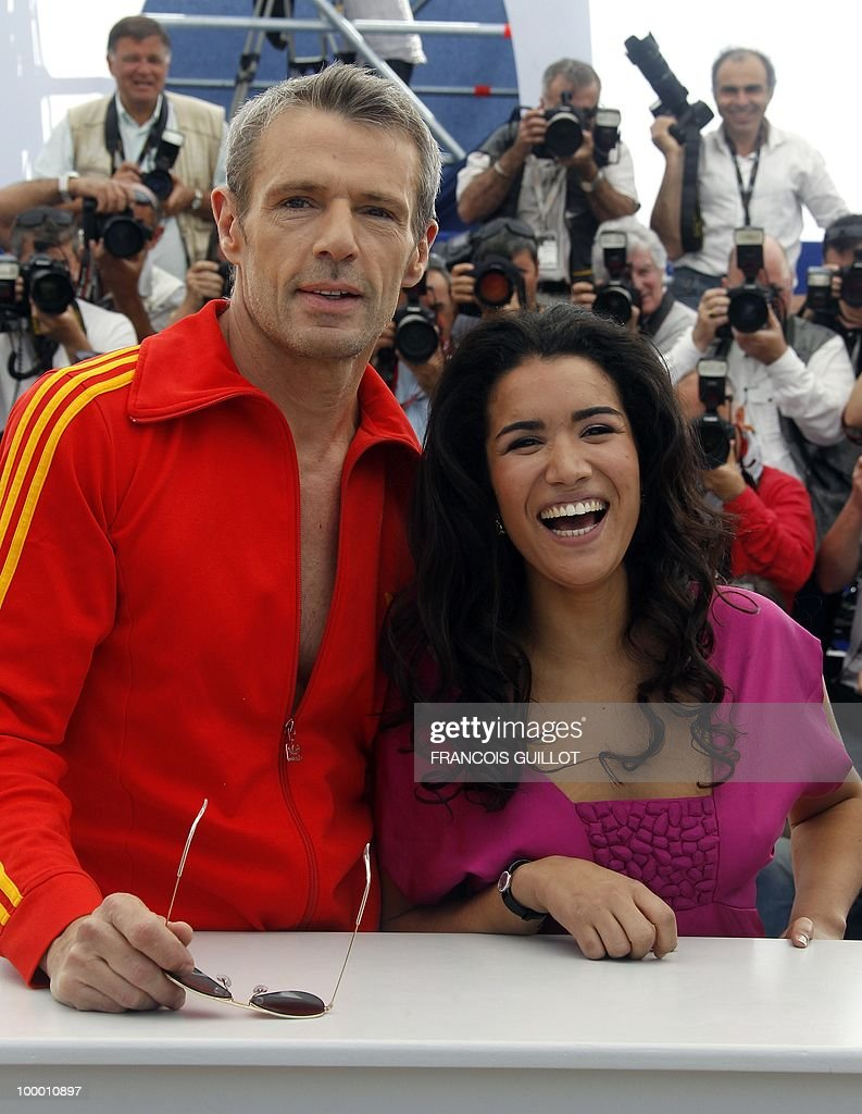 French actor Lambert Wilson poses with French actress Sabrina Ouazani during the photocall of 'Des Hommes et des Dieux' (Of God and Men) presented in competition at the 63rd Cannes Film Festival on May 18, 2010 in Cannes.