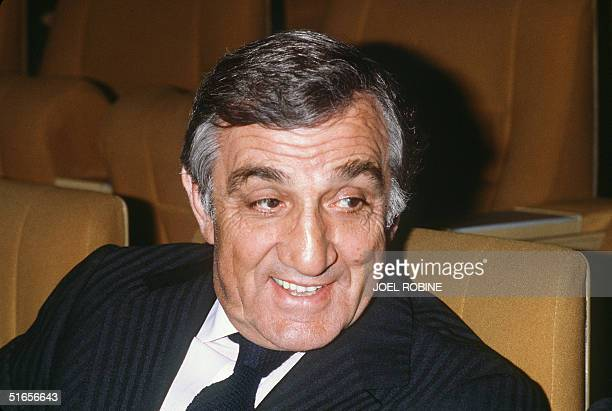 French actor Lino Ventura smiles as he is waiting 18 October 1982 in the Palais des Congres in Paris the first showing of Les Miserables realized by...