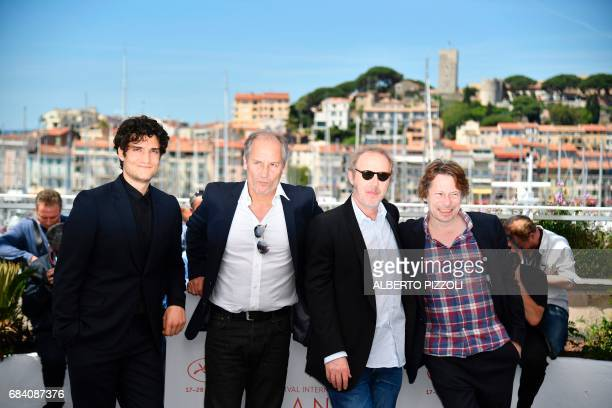 French actor Louis Garrel French actor Hippolyte Girardot French director Arnaud Desplechin and French actor Mathieu Amalric pose on May 17 2017...