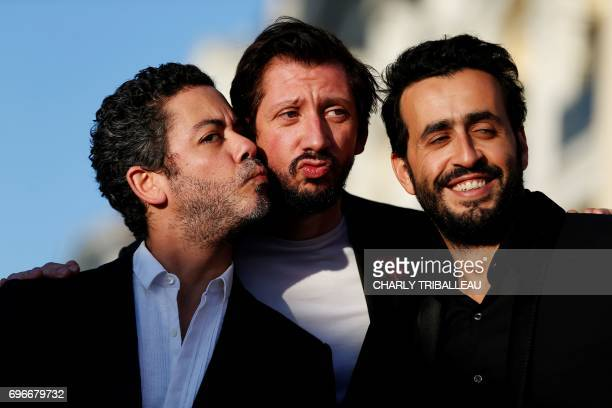 French actor Manu Payet Monsieur Poulpe and Jonathan Cohen pose on the red carpet on June 16 2017 during the Cabourg Romantic Film Festival in...