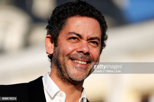 French actor Manu Payet poses on the red carpet on June 16 2017 during the Cabourg Romantic Film Festival in Cabourg northwestern France / AFP PHOTO...