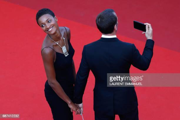 French actor Mathieu Kassovitz and his partner Laura pose as they arrive on May 23 2017 for the '70th Anniversary' ceremony of the Cannes Film...