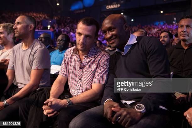 French actor Mathieu Kassovitz speaks with boxer Souleymane Mbaye prior to attend a heavyweight bout at the Zenith in Paris on October 14 2017 / AFP...