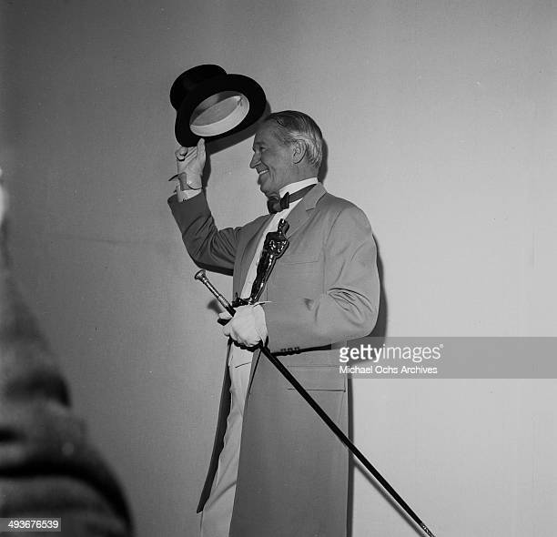 French actor Maurice Chevalier wearing a top hat and coat in Los Angeles California