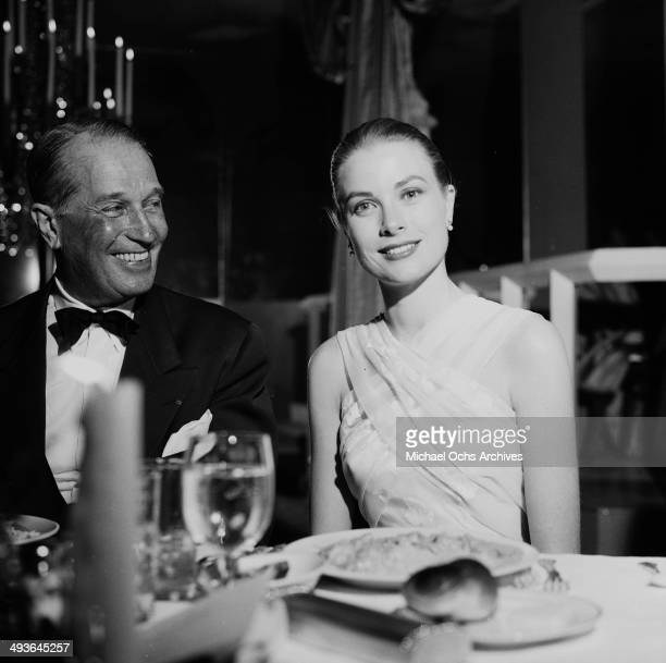 French actor Maurice Chevalier with Grace Kelly attend the Academy Awards show in Los Angeles California