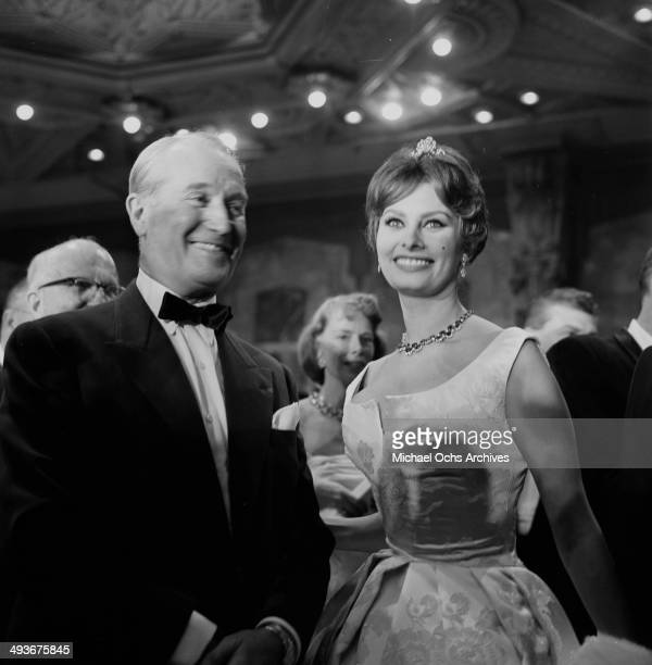 French actor Maurice Chevalier with guest attend a party in Los Angeles California