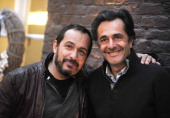 French actor Mehdi El Glaoui and French director and adventurist Nicolas Vanier pose on December 4 2013 at the Gantois hotel in Lille northern France...