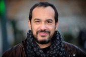 French actor Mehdi El Glaoui poses on December 4 2013 in the streets of Lille northern France before a press presentation of the French movie 'Belle...