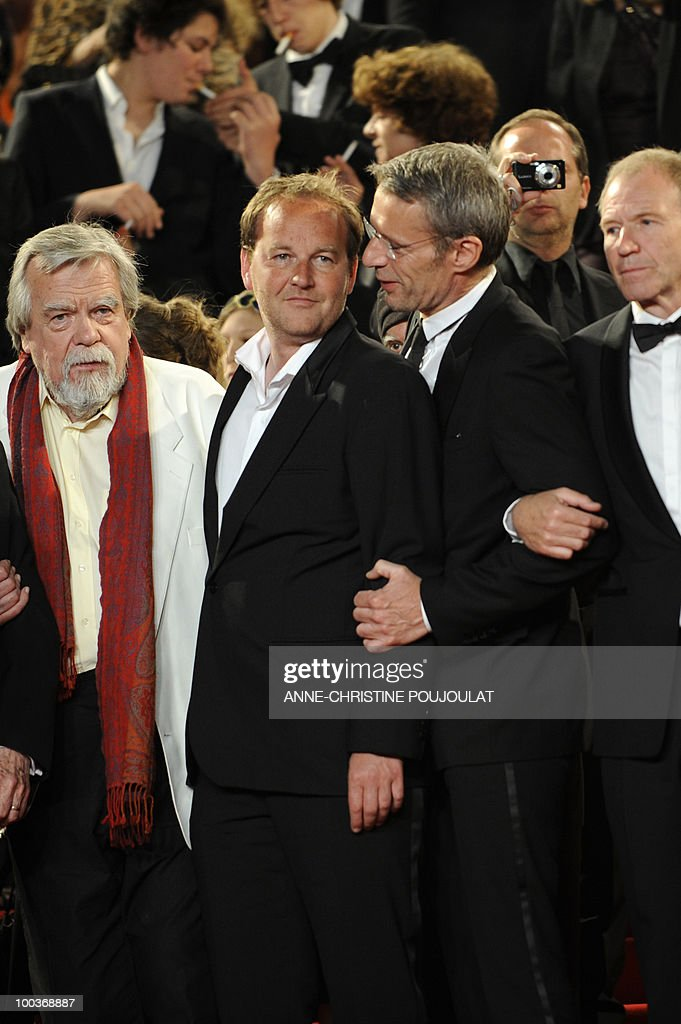 French actor Michael Lonsdale, French director Xavier Beauvois, French actor Lambert Wilson and French actor Xavier Maly leave after the screening of 'Des Hommes et des Dieux' (Of God and Men) presented in competition at the 63rd Cannes Film Festival on May 18, 2010 in Cannes.