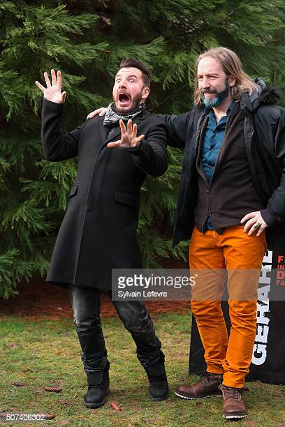 French actor Michael Youn gestures close to director Yann Samuell as they pose during a photo session for the film ' Le fantome de Canterville'...