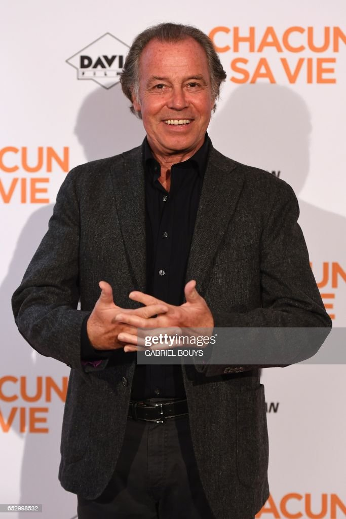 French actor Michel Leeb poses during the photocall for the premiere of the film 'Chacun Sa Vie' in Paris on March 13, 2017. The film is directed by French director Claude Lelouch. /
