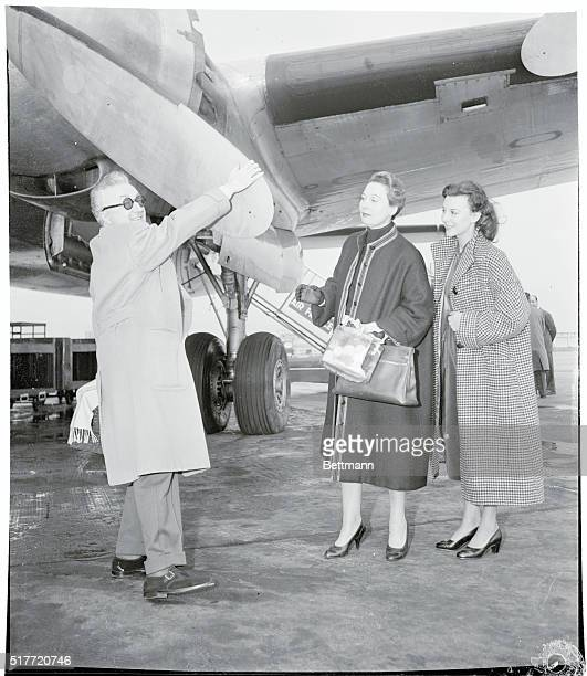 French actor NoelNoel shows off his aeronautical savvy as Arletty and Marie Mansart eye his technique at a Paris airport He served a hitch as a...