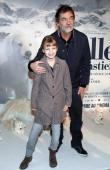 French actor Olivier Marchal and his daughter pose before the presentation of the movie 'Belle and Sébastien' of French film director Nicolas Vanier...