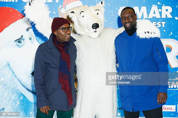 French actor Omar Sy and actor Lucien Jean Baptiste attend 'Norm' Paris Premiere at Mk2 Bibliotheque on December 4 2016 in Paris France