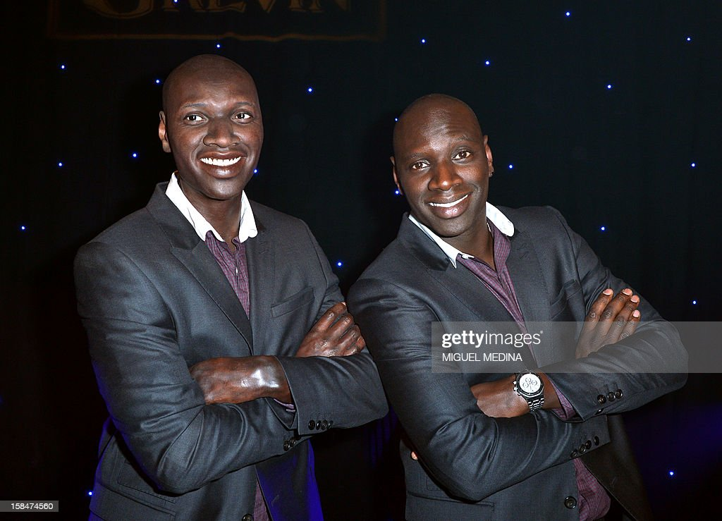 French actor Omar Sy poses next to his wax likeness at the Grevin Museum in Paris on December 17, 2012 during the official presentation of his effigy. AFP PHOTO MIGUEL MEDINA