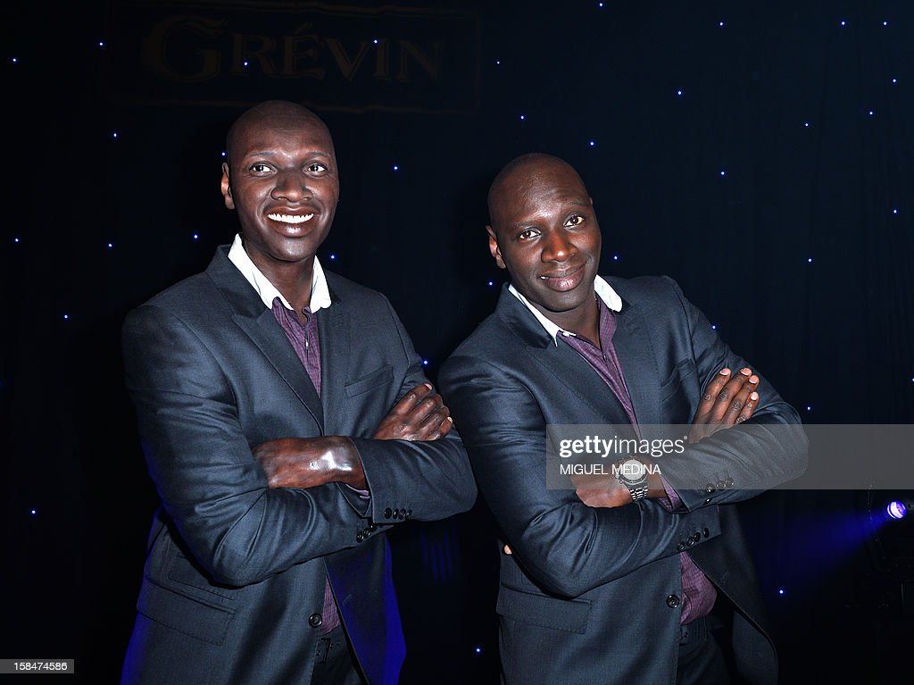 French actor Omar Sy poses next to his wax likeness at the Grevin Museum in Paris on December 17, 2012 during the official presentation of his effigy.