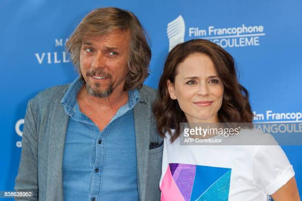French actor Pascal Demolon and Canadian actress Suzanne Clement pose during a photocall for the film 'Le rire de ma mère' during the 10th...