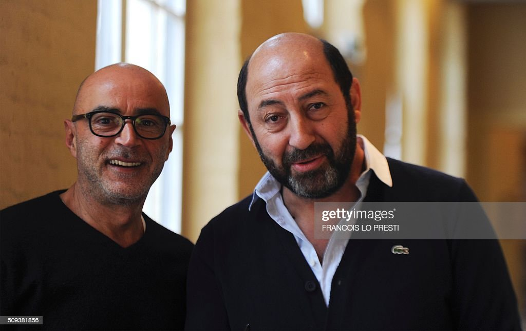 French actor Patrick Bosso (L) and French actor and director Kad Merad pose on February 10, 2016 at the Gantois Holter in Lille, on the sidelines of a press conference for the presentaiton of their latest film 'Marseille'. / AFP / FRANCOIS LO PRESTI