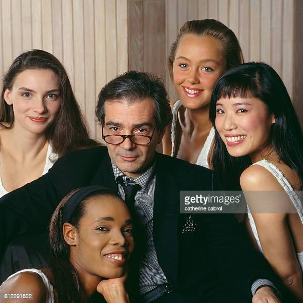 French actor Pierre Arditi surrounded by young women