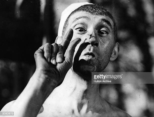 French actor Pierre Fresnay with a fly on his nose in a scene from 'CheriBibi' directed by Leon Mathot for DPF