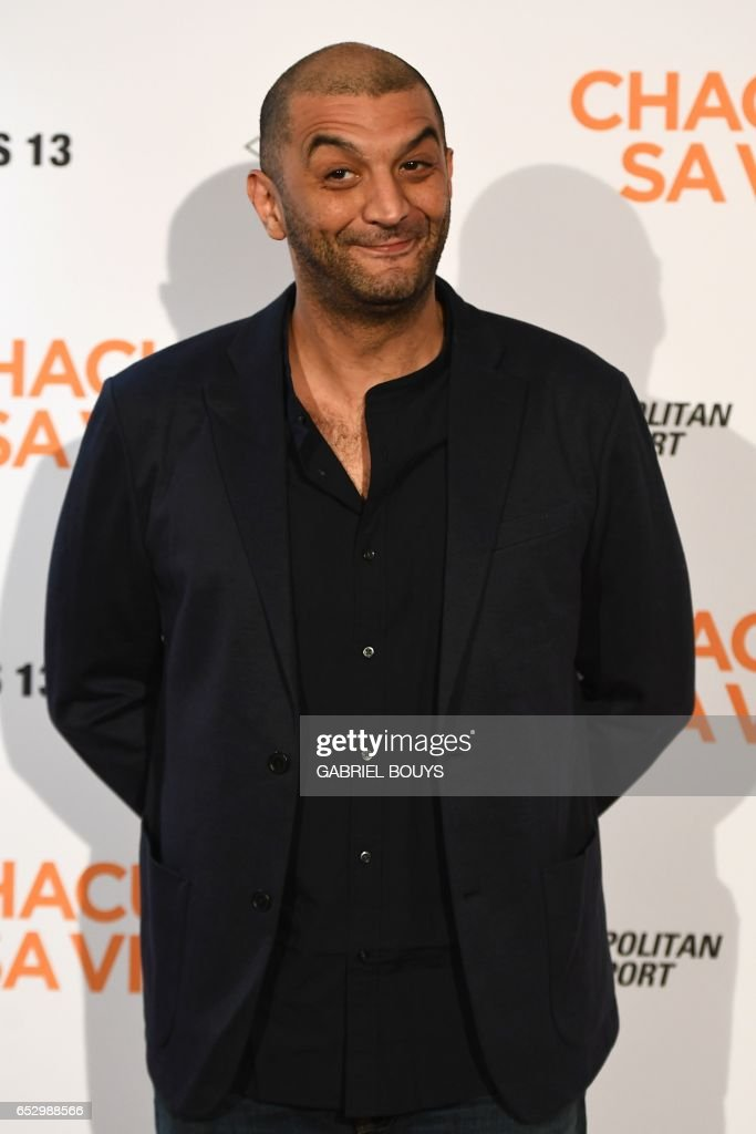 French actor Ramzy Bedia poses during the photocall for the premiere of the film 'Chacun Sa Vie' in Paris on March 13, 2017. The film is directed by French director Claude Lelouch