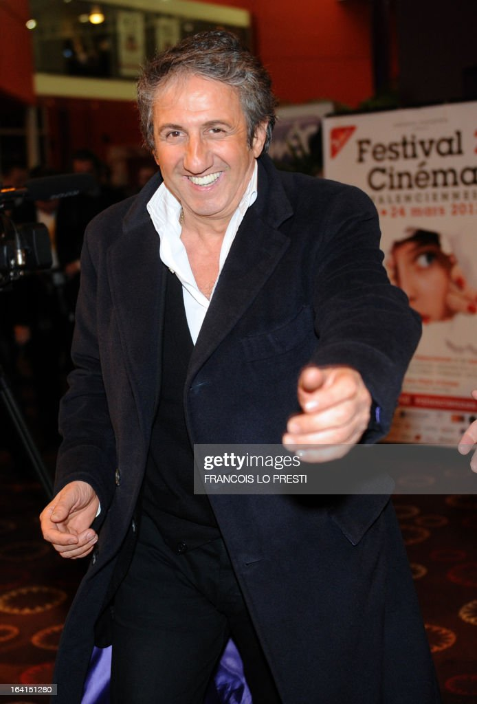 French actor Richard Anconina, President of the Jury for fictions, gestures upon his arrival during Valenciennes Film Festival on March 20, 2013 in Valenciennes, northern France. Valenciennes Film Festival runs from March 18 to 24.