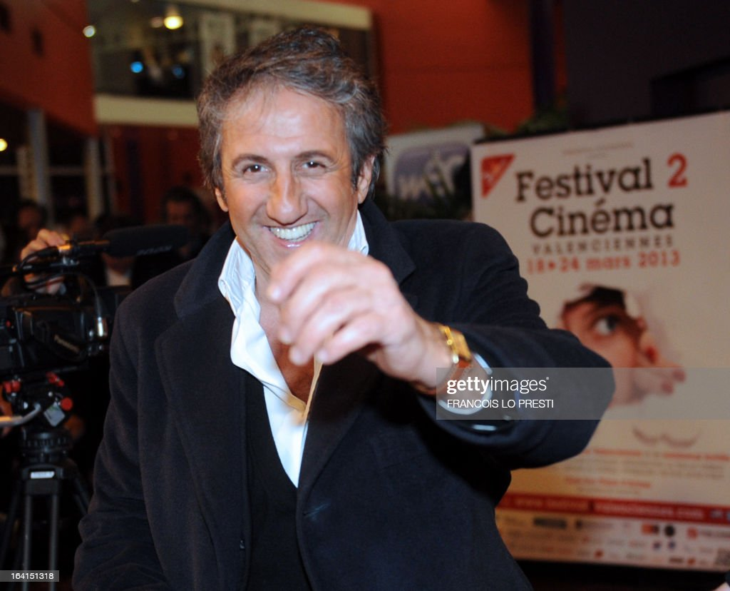French actor Richard Anconina, President of the Jury for fictions, gestures upon his arrival during Valenciennes Film Festival on March 20, 2013 in Valenciennes, northern France. Valenciennes Film Festival runs from March 18 to 24. AFP PHOTO FRANCOIS LO PRESTI