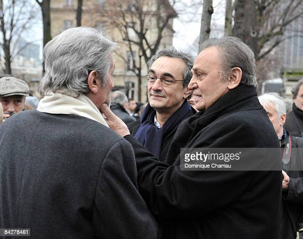 French Actor Roger Hanin and French Actor Alain Delon attend publicist Georges Cravenne's Funeral at Montparnasse Cemetery on January 14 2009 in...