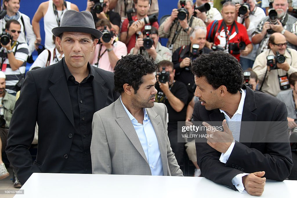 French actor Roschdy Zem, French actor Jamel Debbouze and French actor Sami Bouajila pose during the photocall of 'Hors La Loi' (Outside of the Law) presented in competition at the 63rd Cannes Film Festival on May 21, 2010 in Cannes.