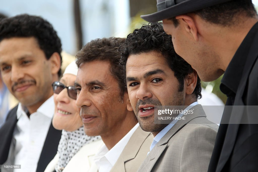 French actor Sami Bouajila, actress Chafia Boudraa, French director Rachid Bouchareb, French actor Jamel Debbouze and French actor Roschdy Zem pose during the photocall of 'Hors La Loi' (Outside of the Law) presented in competition at the 63rd Cannes Film Festival on May 21, 2010 in Cannes.