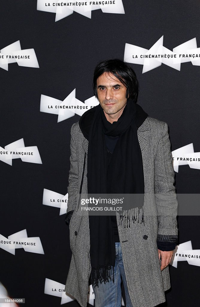 French actor Samuel Benchetrit poses during a photocall prior to the premiere screening of the movie 'Amour', awarded the 2012 Cannes film festival Palme d'Or, on October 15, 2012 in Paris. AFP PHOTO FRANCOIS GUILLOT