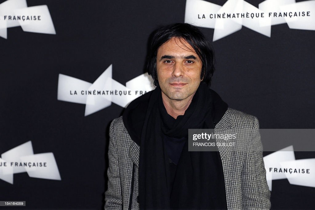 French actor Samuel Benchetrit poses during a photocall prior to the premiere screening of the movie 'Amour', awarded the 2012 Cannes film festival Palme d'Or, on October 15, 2012 in Paris.