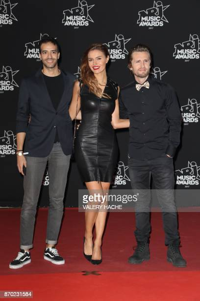 French actor Tarek Boudali French model and actress Nadege Dabrowski aka Andy Raconte and French actor Philippe Lacheau pose upon their arrival to...