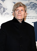 French actor Tcheky Karyo poses before the presenttaion of the movie 'Belle and Sébastien' on November 17 2013 in Paris AFP PHOTO / PATRICK KOVARIK