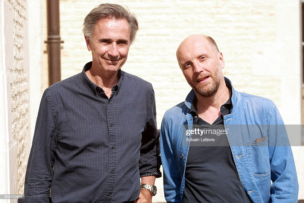French actor <a gi-track='captionPersonalityLinkClicked' href=/galleries/search?phrase=Thierry+Lhermitte&family=editorial&specificpeople=768146 ng-click='$event.stopPropagation()'>Thierry Lhermitte</a> (L) and director Thomas Vincent pose during photo session before press conference for the premiere of the film 'La Nouvelle Vie de Paul Sneijder' on May 27, 2016 in Lille, France.