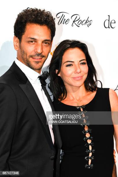French actor Tomer Sisley and Sandra de Matteis pose during a photocall as she arrives to attend the De Grisogono Party on the sidelines of the 70th...