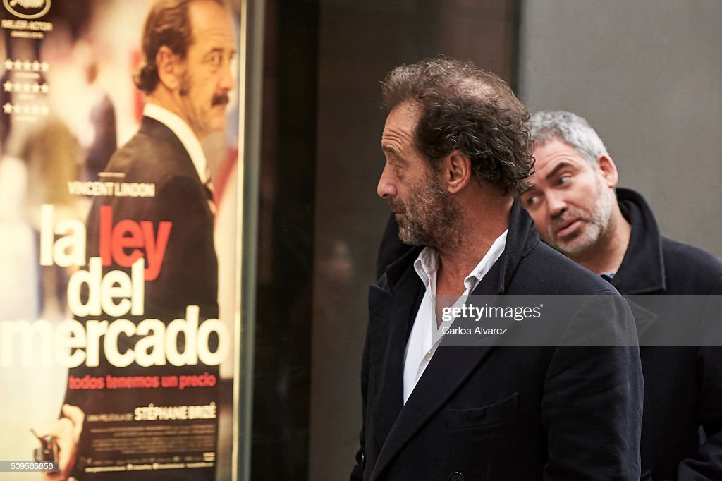French Actor Vincent Lindon (L) and French director Stephane Brize (R) present 'La Loi Du Marche' (The Measure Of A Man) at the Golem cinema on February 11, 2016 in Madrid, Spain.
