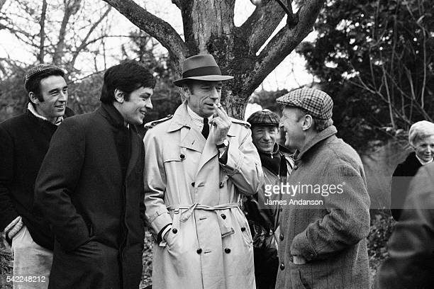 French actors Alain Delon Yves Montand and André Bourvil speaking on the set of Le Cercle Rouge written and directed by JeanPierre Melville