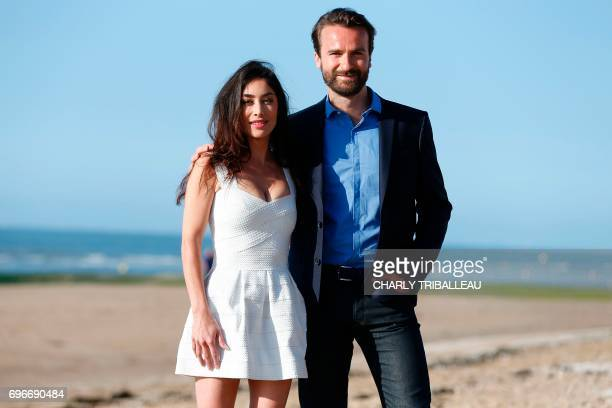French actors Amaury de Crayencour and Fanny Valette pose during a photocall on June 16 2017 at the Cabourg Romantic Film Festival in Cabourg...
