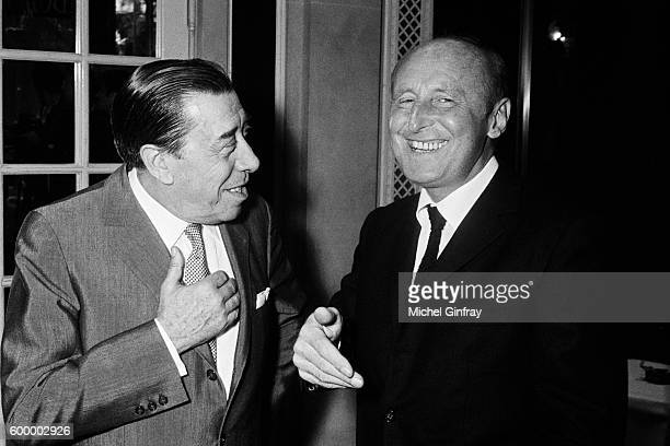 French actors and singers Fernandel and André Bourvil share a laugh
