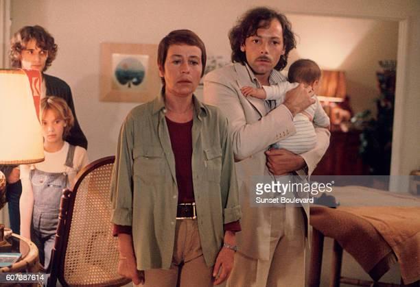French actors Annie Girardot and Patrick Deweare on the set of La clé sur la porte directed by Yves Boisset