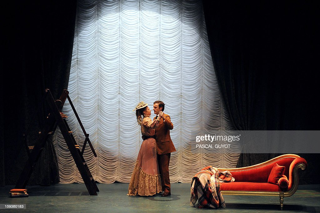 French actors Arnaud Denis and Marilyne Fontaine perform during a rehearsal of the play 'L'importance d'etre serieux' (Importance of being serious) based on a novel by Irish writer Oscar Wilde directed by Gilbert Desveaux on January 11, 2013 Grammont theatre in Montpellier, southern France.