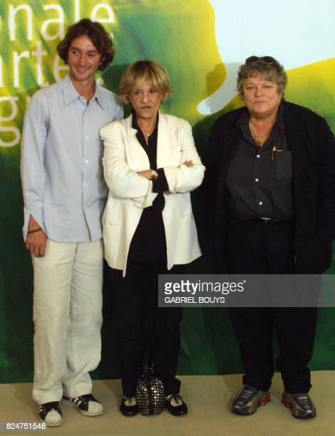 French actors Aymeric Demarigny and Jeanne Moreau pose with director Josee Dayan during the photocall of 'Cet Amourla' out of comptetition at the 58...