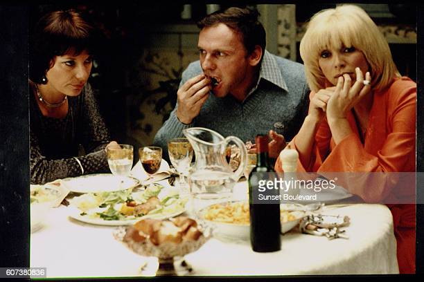 French actors Bernadette Lafont JeanLouis Trintignant and Mireille Darc on the set of L'ordinateur des pompes funèbres written and directed by Gerard...