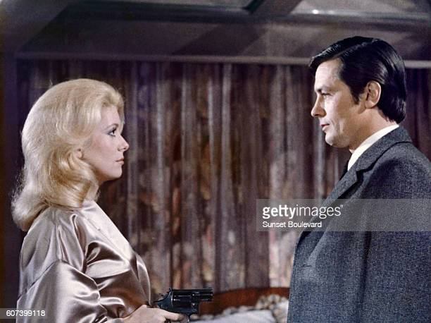 French actors Catherine Deneuve and Alain Delon on the set of Un Flic written and directed by JeanPierre Melville