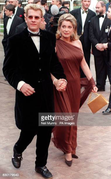 French actors Catherine Deneuve and Guillaume Depardieu arrive for the movie premiere 'Pola X' at the Palais des Festivals during the Cannes Film...