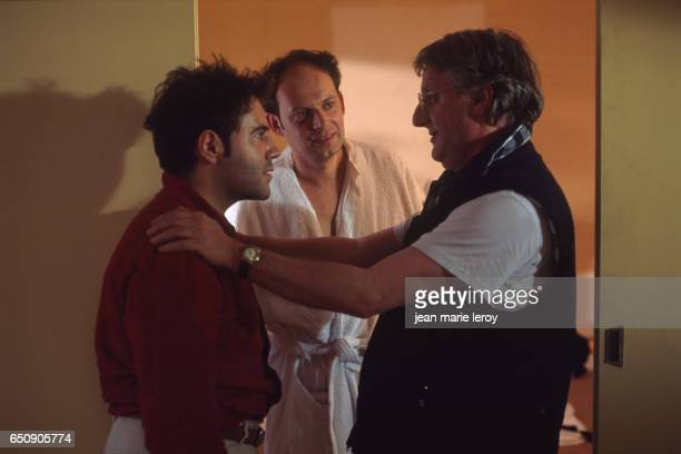 French actors Denis Podalydes and Jose Garcia and director screenwriter and actor JeanLouis Benoit on the set of Benoit's film 'La Mort du Chinois'