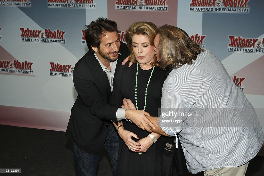 French actors Edouard Baer (L), Catherine Deneuve and Gerard Depardieu attend the 'Asterix & Obelix God Save Britannia' photocall at Hotel de Rome on October 1, 2012 in Berlin, Germany.
