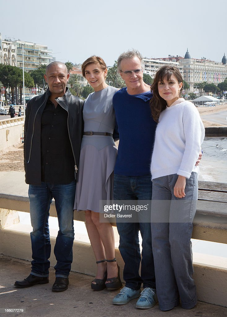 French actors Edouard Montoute, Christophe Lambert, actress <a gi-track='captionPersonalityLinkClicked' href=/galleries/search?phrase=Clotilde+Courau&family=editorial&specificpeople=171279 ng-click='$event.stopPropagation()'>Clotilde Courau</a> (L) and actress Flore Bonaventura (R) pose during a photocall for the tv series'La Source' at MIP TV 2013 on April 8, 2013 in Cannes, France.